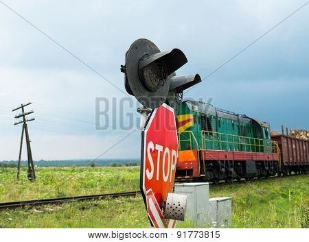 Railroad Crossing Signs And The Approaching Train