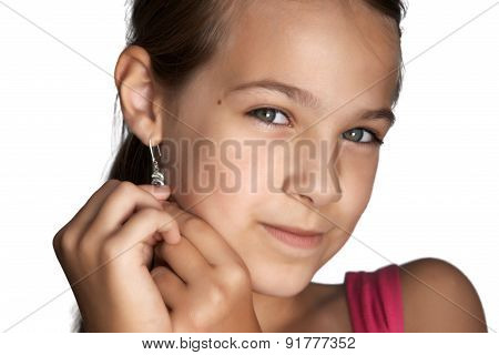 Girl Puts Earrings