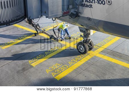 Close Up Of Aircraft Wheel At The Gate