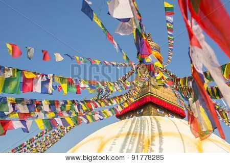 Boudhanath stupa - symbol of Nepal, with colorful prayer flags.
