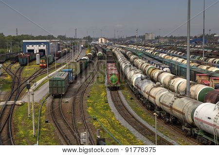Railway Yard With A Lot Of Railway Lines And Freight Trains.