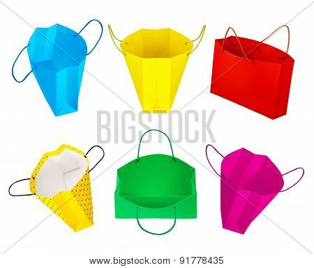 Collection Of Gift Bags In The Air On An Isolated White Background