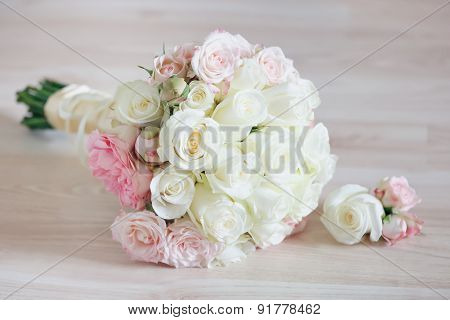 Closeup Of Beautiful Bridal Bouquet On Floor.