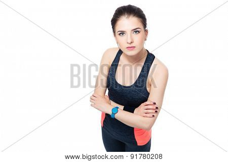 Portrait of a cute fitness woman standing isolated on a white background and looking at camera
