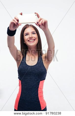 Smiling sporty woman making selfie photo isolated on a white background