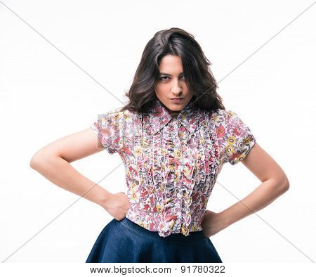 Portrait of a young woman with emotion of offence on her face isolated on a white background. Looking at camera