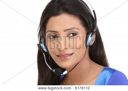 Portrait of beautiful secretary with head phones