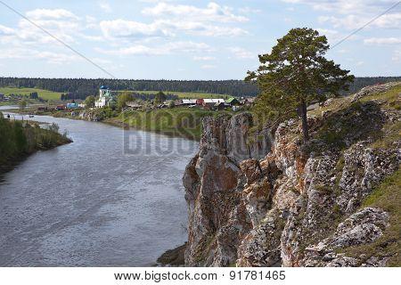The village of Sloboda, Sloboda stone river Chusovaya and St. George's Church. Sverdlovsk region.