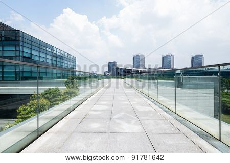 Chengdu,China-July 23,2014:Empty road at modern building exterior in Chengdu.It's epitome of fast development in southwest china.
