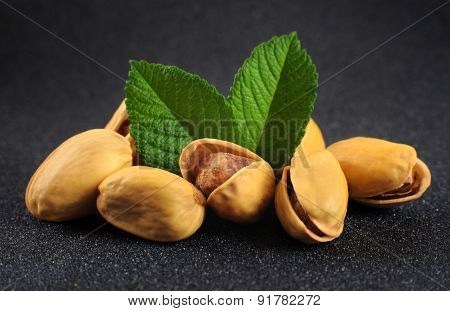 Pistachio Nuts On A Dark Background