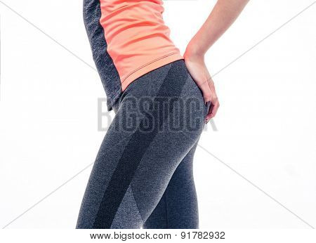 Closeup image of a slender female body in sports wear. Isolated on a white background