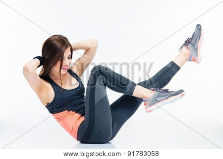 Smiling fitness woman doing abdominal exercises isolated on a white background