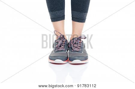 Closeup portrait of a female legs in sportswear