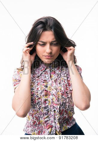 Young woman closed her ears isolated on a white background