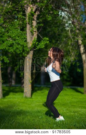 Sport, activity. Cute woman with skipping rope