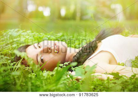 Girl Lying On Grass