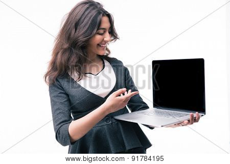 Smiling businesswoman pointing on the laptop screen isolated on a white background