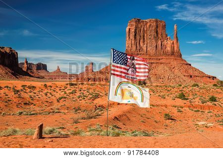 Monument Valley,AZ - CIRCA JULY 2014 -  American and Navajo flags in Desert canyon in USA