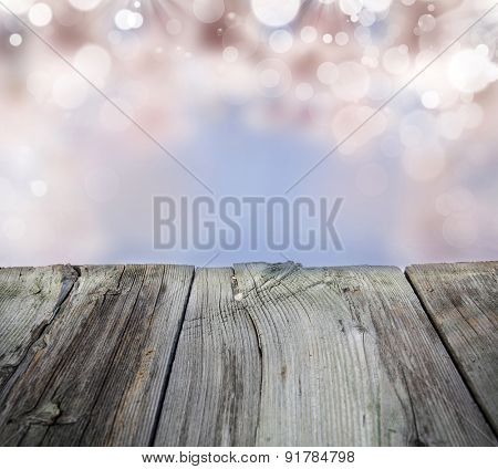 Fresh spring background with bokeh and sunlight and wood floor.