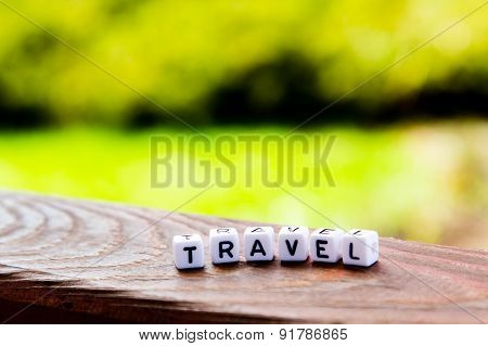 Travel Inscription On Wooden Table On Nature Background