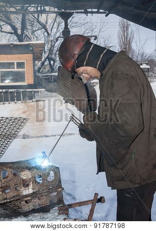 Makeevka, Ukraine - January 14, 2013: Welder Working In The Mine Yard In Winter. The Mine Named Afte
