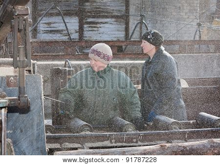 Donetsk, Ukraine - February, 20, 2013: Women Work At Sawing Wood On The Yard Mine Shaft Southern - D
