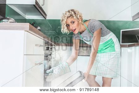 Funny Woman Cook Frying Or Roasting Something In A Oven. Smoke, Vapor Around In The Kitchen Or Home