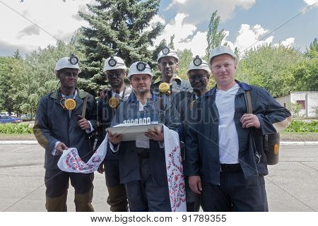 Donetsk, Ukraine - 26 July, 2013: Miners With Coal Symbolic Ingot At The Ceremony In Honor Of 100000