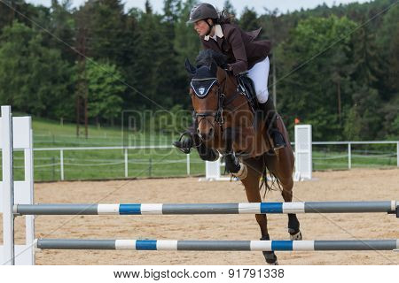 Horsewoman Jump On An Obstacle