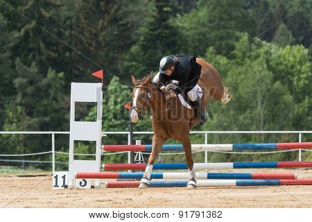 Horsewoman Is Falling From A Brown Horse