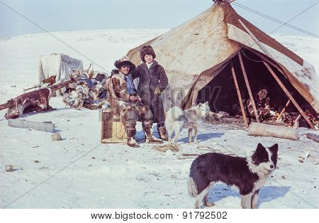 Caucasian woman poses with Chukchi man