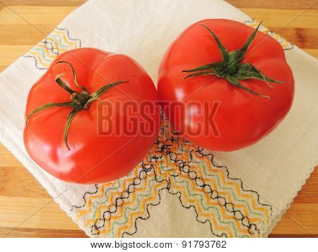 Red tomatoes on a napkin.
