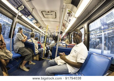 People In The Downtown Metro Bus