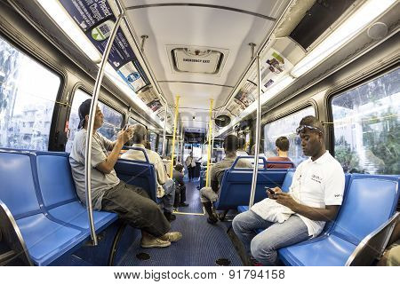 People In The Downtown Metro Bus In The Evening