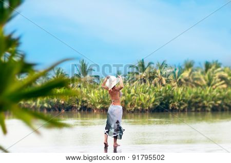 Woman  With Hat Standing From Back