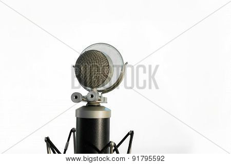 Vocal condenser microphone with wind screen isolated on white background