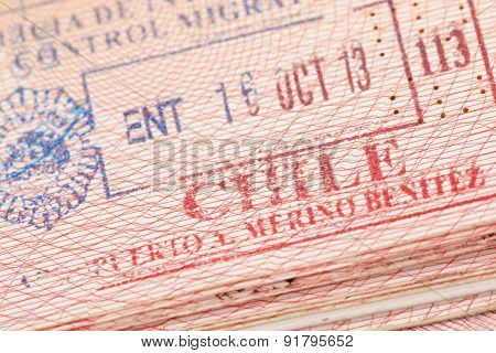Passport page with Chile immigration control entry stamp.