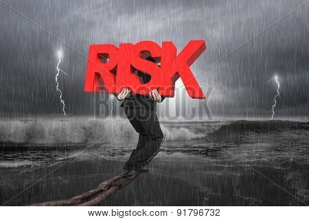 Man Carrying Red Risk Word On Chain With Stormy Ocean