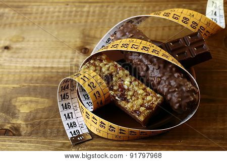 Delicious Chocolate Bars And Peanut Brittle With A Measuring Tape