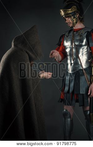 Roman legionary gives a beggar a coin