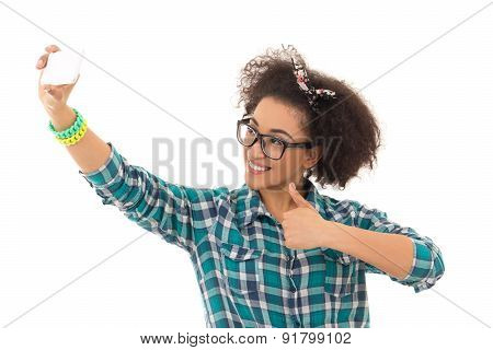 Selfie Concept - Beautiful African American Teenage Girl Taking A Picture Of Herself With Camera Pho