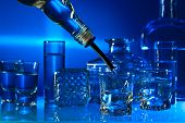 stock photo of vodka  - vodka in bar on a glass table - JPG