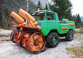 picture of mountain chain  - A snow removal vehical with snow chains in Friuli - JPG