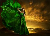 image of waving  - Woman Fashion Dress Fluttering On Wind Elegant Girl Portrait Model Posing In Green Silk Gown Fabric Cloth Waving Over Night Sky - JPG