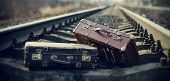 picture of old suitcase  - Two old vintage suitcases lie on railway tracks - JPG