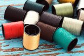 pic of tailoring  - colorful thread needlework embroidery tailor craft repair background blue wood teak still life vintage - JPG