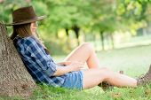 foto of cowgirl  - Cute cowgirl restung under the tree - JPG