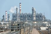 stock photo of chimney  - Industrial landscape with chimneys tank - JPG