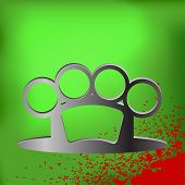picture of brass knuckles  - Metal Brass Knuckle and Drops of Blood on Green Background - JPG