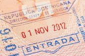 stock photo of dodo  - Passport page with Dominican Republic immigration control entry stamp. ** Note: Shallow depth of field - JPG